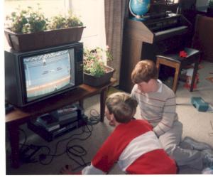 Aaron watching Tommy play Nintendo